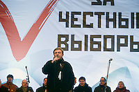 "Moscow, Russia, 24/12/2011..Opposition politician Grigory Yavlinsky speaks to an estimated crowd of up to 100,000 gathered to protest against election fraud and Prime Minister Vladimir Putin in the largest anti-government demonstration in Russia since the collapse of the Soviet Union. The banner behind reads ""For Honest Elections""."