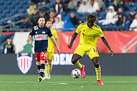 FOXBOROUGH, MA - AUGUST 4: C.J. Sapong #17 of Nashville SC dribbles during a game between Nashville SC and New England Revolution at Gillette Stadium on August 4, 2021 in Foxborough, Massachusetts.
