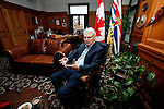 Premier Gordon Campbell answers year-end questions by Canadian Press reporter, Dirk Meissner, in his office at the British Columbia Legislature in Victoria, BC. Photo assignment for Canadian Press (CP) news wire service.