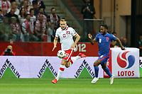 8th September 2021; PGE National Stadium, Warsaw, Poland: FIFA World Cup 2022 Football qualification, Poland versus England;  TYMOTEUSZ PUCHACZ beaten by the run from RAHEEM STERLING