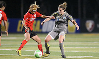 Atlanta midfielder Mami Yamaguchi (9) battles Philadelphia midfielder Jen Buczkowski (4) for the ball.  Atlanta and Philadelphia played to a 0-0 draw in the season opener for both teams at John A Farrell Stadium in West Chester, PA.