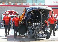 Apr 12, 2015; Las Vegas, NV, USA; Crew members for NHRA funny car driver Alexis DeJoria during the Summitracing.com Nationals at The Strip at Las Vegas Motor Speedway. Mandatory Credit: Mark J. Rebilas-