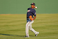 Julio Teheran #27 of the Gwinnett Braves warms up in the outfield prior to his start against the Charlotte Knights at Knights Stadium on April 25, 2011 in Fort Mill, South Carolina.    Photo by Brian Westerholt / Four Seam Images