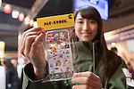 A Pac-Store staff member shows their products during the Moshi Moshi Nippon Festival 2016 on November 26, 2016 in Tokyo, Japan. Moshi Moshi Nippon Festival 2016 aims to promote Japanese pop culture (fashion, anime, technology, music and food) to the world, and non-Japanese visitors are able to enter the event for free by showing their passport. This year's two day event included live shows by Japanese pop stars Silent Siren, Dempagumi.inc, Tempura Kids, Capsule and Kyary Pamyu Pamyu at the Tokyo Metropolitan Gymnasium. (Photo by Rodrigo Reyes Marin/AFLO)