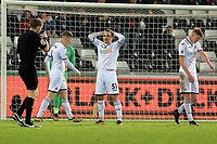 Roque Mesa of Swansea City (C) shows his frustration when referee Craig Pawson (L) points to the penalty spot during the Premier League match between Swansea City and Crystal Palace at The Liberty Stadium, Swansea, Wales, UK. Saturday 23 December 2017