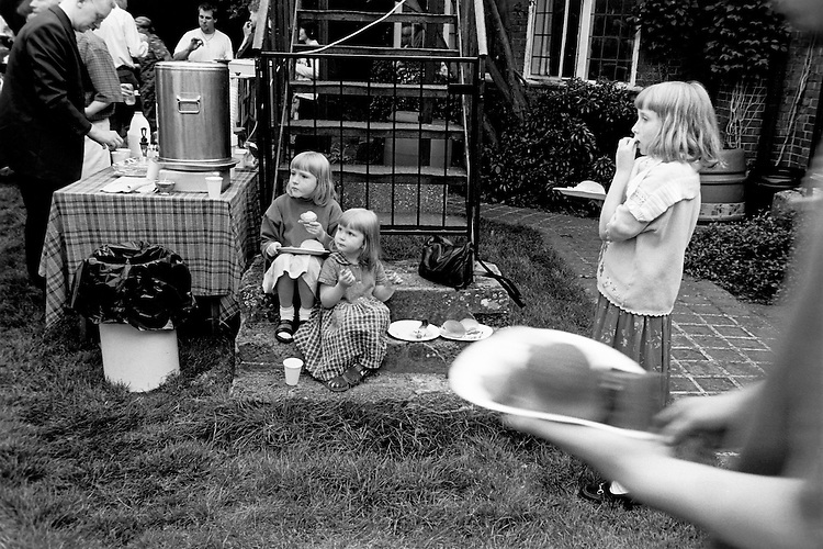 © John Angerson.Communal meal at Cornhill Manor, Northamptonshire. Food and household supplies are bought in bulk and then distributed to the sixty community houses across the UK.