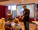 """July 26, 2017. Raleigh, North Carolina.<br /> <br /> Alan Gratz discusses his new book """"Refugee"""" with early arrivers to the signing event. <br /> <br /> Author Alan Gratz spoke about and signed his new book """"Refugee"""" at Quail Ridge Books. The young adult fiction novel contrasts the stories of three refugees from different time periods, a Jewish boy in 1930's Germany , a Cuban girl in 1994 and a Syrian boy in 2015."""