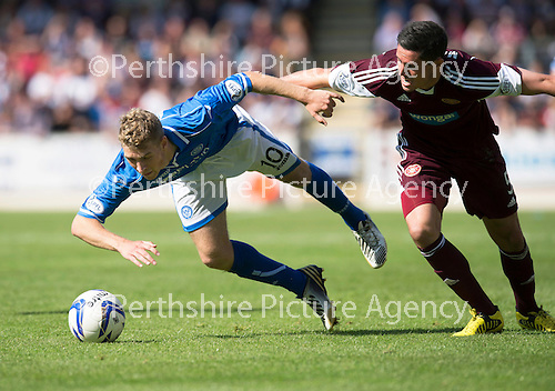 St Johnstone v Hearts...04.08.13 SPFL<br /> David Wotherspoon is brought down by Dylan McGowan<br /> Picture by Graeme Hart.<br /> Copyright Perthshire Picture Agency<br /> Tel: 01738 623350  Mobile: 07990 594431