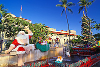 Daytime view of Hawaiian Santa  & Christmas tree at Honolulu Hale