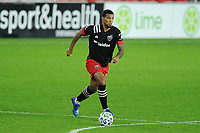 WASHINGTON, DC - OCTOBER 28: Gelmin Rivas #20 of D.C. United moves the ball during a game between Columbus Crew and D.C. United at Audi Field on October 28, 2020 in Washington, DC.