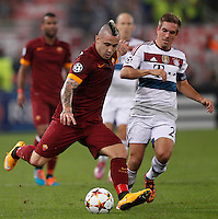 Calcio, Champions League, Gruppo E: Roma vs Bayern Monaco. Roma, stadio Olimpico, 21 ottobre 2014.<br /> Roma's Radja Nainggolan is challenged by Bayern's Philipp Lahm, right, during the Group E Champions League football match between AS Roma and Bayern at Rome's Olympic stadium, 21 October 2014.<br /> UPDATE IMAGES PRESS/Isabella Bonotto