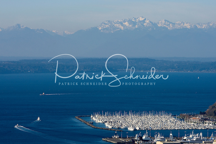 View looking out over Elliot Bay toward the Olympic Mountains in Seattle Washington.