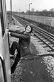 Woman tube train driver boarding the cab on a District Line train at Barking depot.