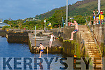 Cooling off in the evening heat with a jump from the Pier at Cahersiveen on Monday were l-r; Alex Coffey, Adam Murphy & Sam O'Driscoll.