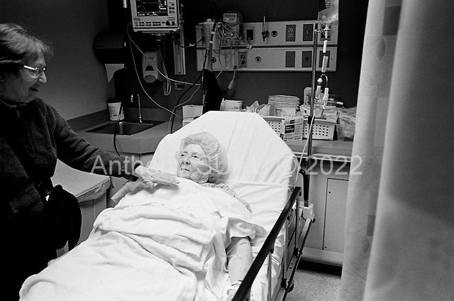 Chicago, Illinois<br /> USA<br /> December 17, 2009<br /> <br /> At the University of Chicago Medical Center Geraldine Martin, 80 years old, is prepared for open heart surgery to have a valve replaced and hole repaired. She is accompanied by her sister Helen Martin prior to the surgery and performs a basic soothing with her hands of her sisters heart and body.