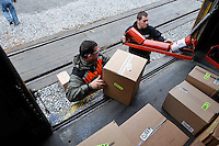 Conductor Charles Baldwin, left, helps an Alaska Railroad employee unload equipment used at the railroad's rock quarry in Curry, Alaska. The Alaska Railroad's Hurricane Turn is one of America's last true whistlestop trains.