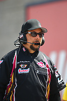Apr 10, 2015; Las Vegas, NV, USA; Richard Hartman crew chief for NHRA funny car driver Tim Wilkerson (not pictured) during qualifying for the Summitracing.com Nationals at The Strip at Las Vegas Motor Speedway. Mandatory Credit: Mark J. Rebilas-