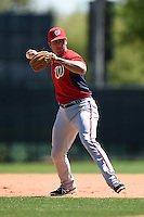 Washington Nationals infielder Carlos Lopez (6) during practice before a minor league spring training game against the Atlanta Braves on March 26, 2014 at Wide World of Sports in Orlando, Florida.  (Mike Janes/Four Seam Images)