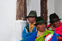 """Old women, wearing colorful clothes, watch a procession during the Inti Raymi celebration in Pichincha province, Ecuador, 26 June 2010. Inti Raymi, """"Festival of the Sun"""" in Quechua language, is an ancient spiritual ceremony held in the Indian regions of the Andes, mainly in Ecuador and Peru. The lively celebration, set by the winter solstice, goes on for various days. The highland Indians, wearing beautiful costumes, dance, drink and sing with no rest. Colorful processions in honor of the God Inti (Sun) pass through the mountain villages giving thanks for the harvest and expressing their deep relation to the Mother Earth (Pachamama)."""
