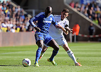 Sunday, 13 April 2014<br /> Pictured L-R: Demba Ba of Chelsea challenged by Angel Rangel of Swansea. <br /> Re: Barclay's Premier League, Swansea City FC v Chelsea at the Liberty Stadium, south Wales,