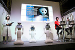 """SoftBank robots Pepper perform during the Niconico Douga fan event at Makuhari Messe International Exhibition Hall on April 25, 2015, Chiba, Japan. The event includes special attractions such as J-pop concerts, Sumo and Pro Wrestling matches, cosplay and manga and various robot performances and is broadcast live on via the video-sharing site. Niconico Douga (in English """"Smiley, Smiley Video"""") is one of Japan's biggest video community sites where users can upload, view, share videos and write comments directly in real time, creating a sense of a shared watching. According to the organizers more than 200,000 viewers for two days will see the event by internet. The popular event is held in all 11 halls of the huge Makuhari Messe exhibition center from April 25 to 26. (Photo by Rodrigo Reyes Marin/AFLO)"""