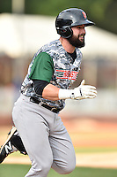 Augusta GreenJackets catcher Matt Winn (16) runs to first base during a game against the Asheville Tourists at McCormick Field on July 21, 2016 in Asheville, North Carolina. The GreenJackets defeated the Tourists 6-3. (Tony Farlow/Four Seam Images)