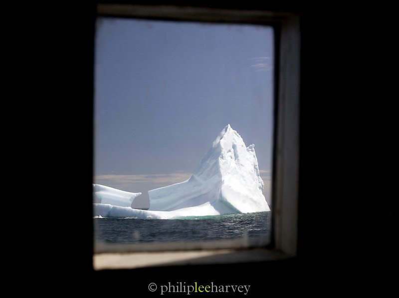 Iceberg as seen through window of a boat, floating near to St Anthony, Newfoundland and Labrador, Canada