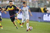Santa Clara, CA - Friday June 03, 2016: United States midfielder Christian Pulisic (17) is marked by Colombia midfielder Daniel Torres (16) during a Copa America Centenario Group A match between United States (USA) and Colombia (COL) at Levi's Stadium.