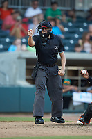 Home plate umpire Josh Gilreath makes a strike call during the South Atlantic League game between the Kannapolis Intimidators and the Augusta GreenJackets at SRG Park on July 6, 2019 in North Augusta, South Carolina. The Intimidators defeated the GreenJackets 9-5. (Brian Westerholt/Four Seam Images)