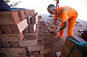 01/10/15<br /> <br /> A man checks and stacks some of the 18,000 bricks he is due to move today.<br /> <br /> ***Full story here:  http://www.fstoppress.com/articles/london-bricks/  ***<br /> <br /> Triathletes have recently coined the term 'brick workout' to describe their gruelling training regime when running, following tough sessions on their bicycles.<br /> <br /> These men, 21 on every shift, each pick-up, inspect, and re-stack 18,000 London Bricks every day.<br /> <br /> One brick weighs 2 kg – so each man lifts the equivalent of almost 40 tons every day at the brick works, near Peterborough, where 2.8 million bricks are made each week.<br /> <br /> All Rights Reserved: F Stop Press Ltd. +44(0)1335 418365   www.fstoppress.com.