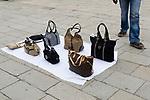 Venice Italy, North African man selling fake designer handbags. 2009.