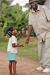 A doting man greets a happy girl in  Barranco, Belize. Baranco is a Garrifuna village bordering Sarstoon-Temash National Park.