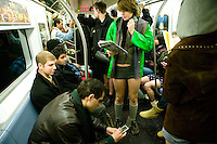 22 January 2006 - New York City, NY - Participants in the 5th annual No Pants Subway Ride travel on the #6 line without pants in New York City, USA, 22 January 2006. The artists and pranksters of the Improv' Everywhere group organised the ride, which gathered over 150 participants, in order to surprise and amuse other passengers and themselves. The police issued summons and handcuffed several participants. Photo Credit: David Brabyn.