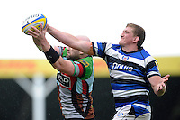 George Robson of Harlequins steals the lineout ball from Stuart Hooper of Bath Rugby during the Aviva Premiership match between Harlequins and Bath Rugby at The Twickenham Stoop on Saturday 10th May 2014 (Photo by Rob Munro)
