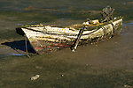 A boat that is stuck in the mud in Faro, capital city of the Algarve, Portugal.