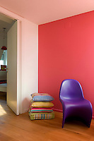 The decoration of the hallway was inspired by the pink palette of the Mexican architect, Luis Barragan, its colour emphasised by a bright purple Verner Panton chair