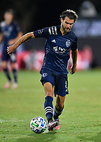 LAKE BUENA VISTA, FL - JULY 26: Graham Zusi of Sporting KC dribbles the ball away from Ali Adnan of Vancouver Whitecaps FC during a game between Vancouver Whitecaps and Sporting Kansas City at ESPN Wide World of Sports on July 26, 2020 in Lake Buena Vista, Florida.