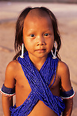 A-ukre village, Brazil. Kayapo boy wearing lots of blue beads; Xingu Indigenous Area, Para State.