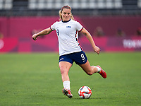 KASHIMA, JAPAN - AUGUST 2: Lindsey Horan #9 of the USWNT passes the ball during a game between Canada and USWNT at Kashima Soccer Stadium on August 2, 2021 in Kashima, Japan.