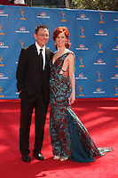 LOS ANGELES - AUG 29:  Michael Emerson and actress Carrie Preston arrives at the 2010 Emmy Awards at Nokia Theater at LA Live on August 29, 2010 in Los Angeles, CA
