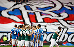 Rangers and Hibs exchange handshakes as the fans get ready for the match
