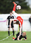 Colin Smyth of Newmarket Celtic goes flying over Adrian Power of Janesboro during their Munster Junior Cup semi-final at Limerick. Photograph by John Kelly.