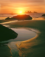 Sunset light on the Pacific Ocean; Bandon State Park, OR
