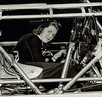 They're capable; these woman; the foremen say. Louise Therriault of Montreal is seen in a bomber cockpit; connecting switch boxes; smiling as she works<br /> <br /> PHOTO :    - Toronto Star Archives - AQP