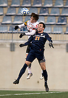 Mikey Ambrose (5) of Maryland goes up for a header with Ryan Zinkhan (21) of Virginia during the NCAA Men's College Cup semifinals at PPL Park in Chester, PA.  Maryland defeated Virginia, 2-1.