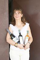 Olivera Juricic, the owner, holding bottles from the winery. Vita@I Vitaai Vitai Gangas Winery, Citluk, near Mostar. Federation Bosne i Hercegovine. Bosnia Herzegovina, Europe.