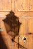 shadow of a street lamp at a wooden door<br /> <br /> sombra de una linterna en una puerta de madera<br /> <br /> Schatten einer Straßenlaterne auf einer Holztür