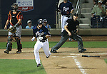 Reno Aces' Jack Reinheimer hits a single down the first base line against the Sacramento River Cats at Greater Nevada Field in Reno, Nev., on Tuesday, July 26, 2016.  <br />Photo by Cathleen Allison