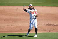 Baltimore Orioles shortstop Freddy Galvis (2) throws to first base during a Major League Spring Training game against the Pittsburgh Pirates on February 28, 2021 at Ed Smith Stadium in Sarasota, Florida.  (Mike Janes/Four Seam Images)