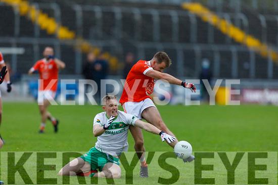 Ballydonoghue's Jason Foley makes a valiant effort in stopping Brosna's Timmy Finnegan scoring effort in the Premier Junior Football Championship Semi-Final